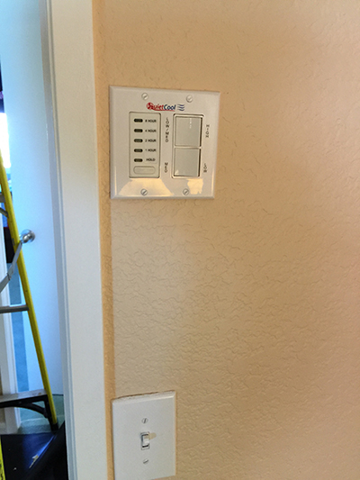Installation includes a wall mounted electronic timer and speed control.