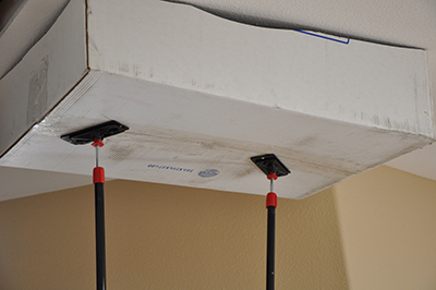 We use spring-loaded poles to hold a dust catching box right under the ceiling to ensure no dust gets away.